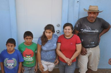 carmen-carlos-and-kids-receive-house-keys