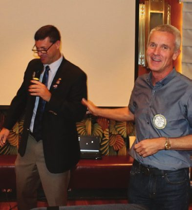 Past President Tom Thomas receives a recognition award from