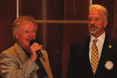 Sargent-at-Arms Kirk Alexander gives the mic to Tom Krob who brought us up to date on the Santa Clothes event