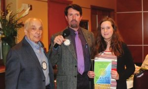 Sargent-At-Arms John Ingeme recognizes Bill Houghton's daughter Peyton who did a Rotary makeup in Playa Del Carmen.