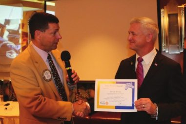 """President Dave presents our speaker Steven Seroka """"The Colonel"""" with our Sole Power Award."""