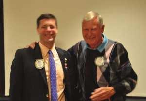Dave Thorson gives Paul Harris +4 award to Lloyd Sauter.