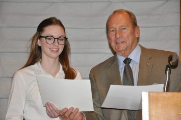 Brock Fraser presents third place award
