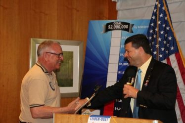 President Dave presents Ted McAdam with a Four Way Test Coin for his service to the club.