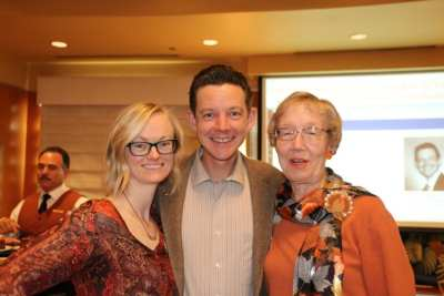 Kirk Holmes poses with his mother Sandy and his partner Becca.