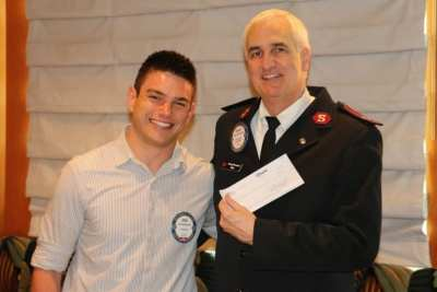 Erik Astramecki presented a check to the Salvation Army for $7,656.60 for the canned food drive. Great job Erik.