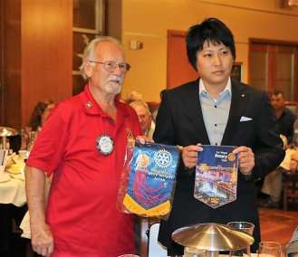 Bob Werner exchanged banners with a visitor from Japan.