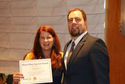 """President Michael awarded our speaker Major Debra March with our """"Share What You Can"""" award."""