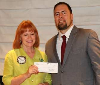 President Michael presented a pot winning check to Arleen Sirois for pulling the joker.