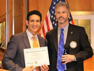 """President Jim presented our speaker Dr. Marwan Sabbagh of the Lou Ruvo Center with our """"Share What You Can Award""""."""