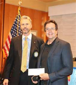 President Jim presented Mark Brown with a check on behalf of Las Vegas Rotary and Howard and Howard.