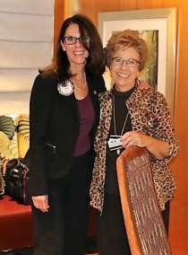 Carolyn Sparks was presented her Lawry bucks by Rosalee Hedrick.