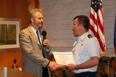 """President Jim presented our speaker with our """"Share What You Can Award""""."""