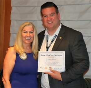 """President Jackie presented our speaker with a """"Share What You Can"""" award to benefit the local USO."""