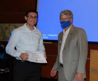 Daniel Reichman spoke on Artificial Intelligence and was awarded the Share What You Can Award by President Richard Jost.
