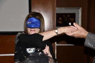 Toni blindfolds herself to pick the raffle winners