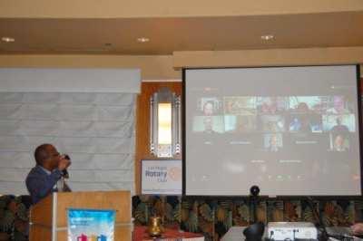 Kim Nyoni presents a Paul Harris +2 award to Jerry Engel