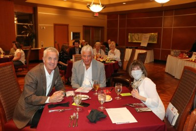 Head table guests Tom Thomas, speaker Jack Sheehan, and Toni Kern