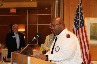 Capt. Anthony Barnes delivers the invocation