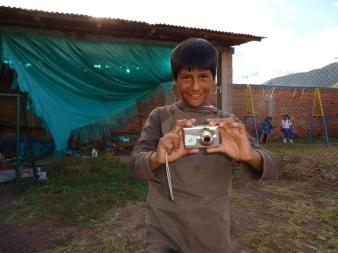 boy-with-camera-shrunk