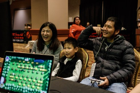 Photo of Chinese family playing Bomber Barn at Gameacon NYC 2018