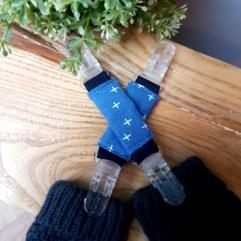 attache gants manteau étoiles