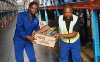 Warehouse staff in South Africa move boxes