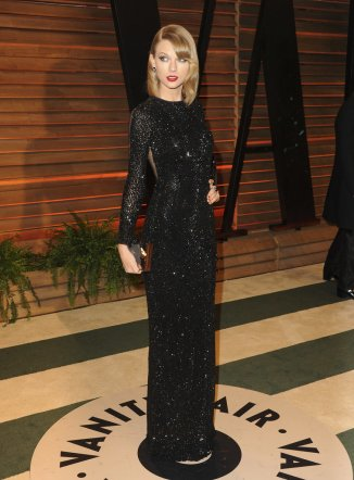 Taylor Swift wore a Julien Macdonald dress, Emm Kuo clutch, Tamara Mellon shoes, and Lorraine Schwartz jewelry {Vanity Fair Oscar Party hosted by Graydon Carter}