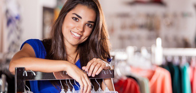 Latina shopping at a small business marketing to Latinos