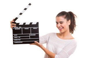 Woman holding a clapboard