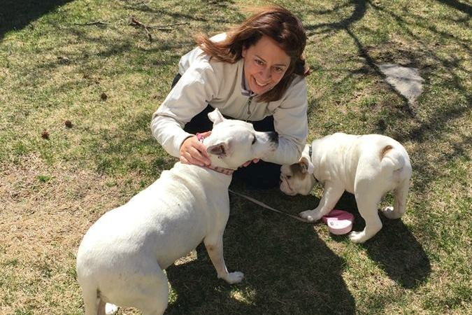 Idania Woof Woof outside with dogs