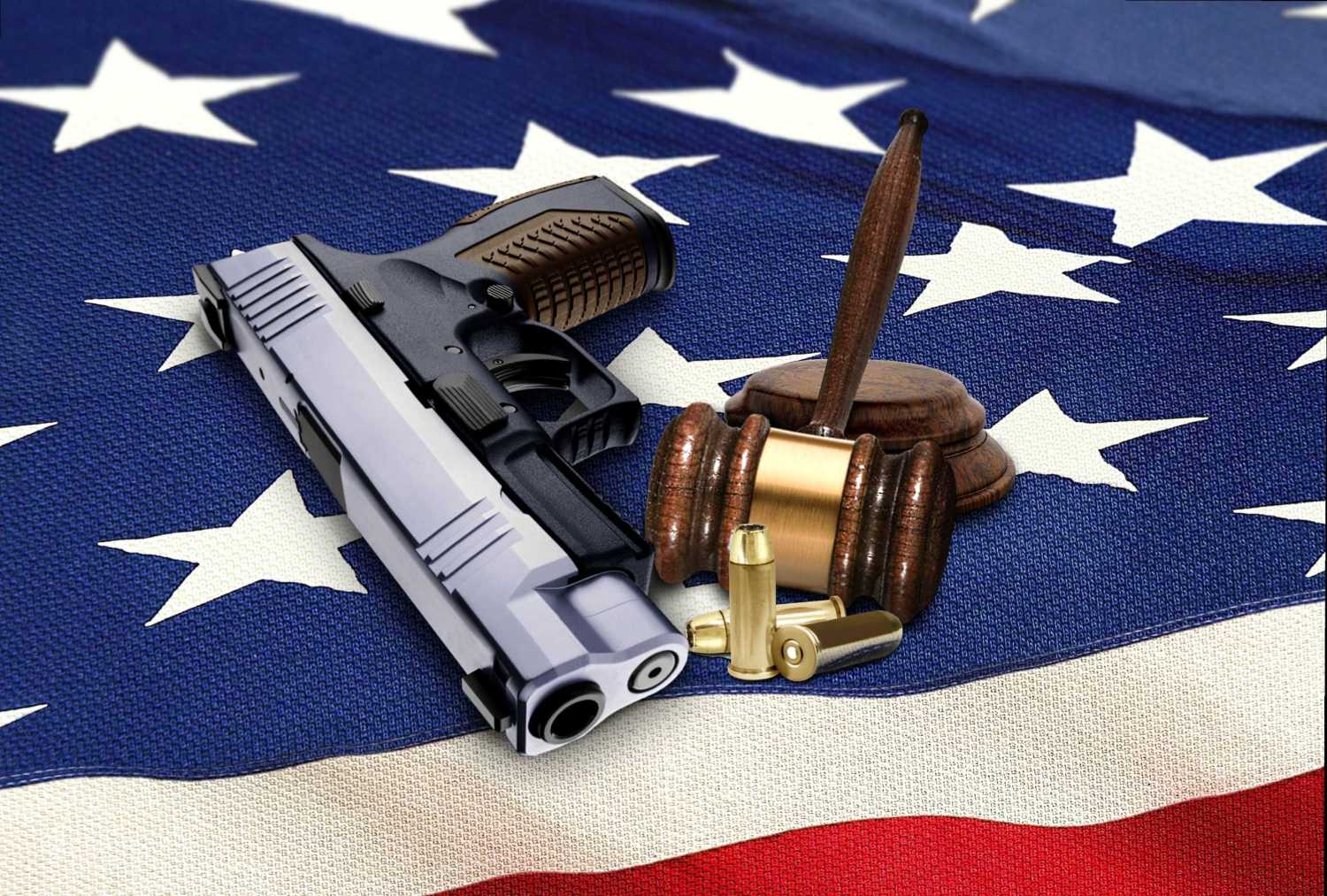 Hand Gun with Gavel and Bullets on American Flag