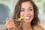 Smiling Woman eating healthy