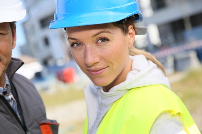 Portrait of woman engineer working on building site
