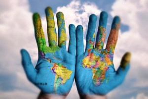 Hands with world map traveler or passenger