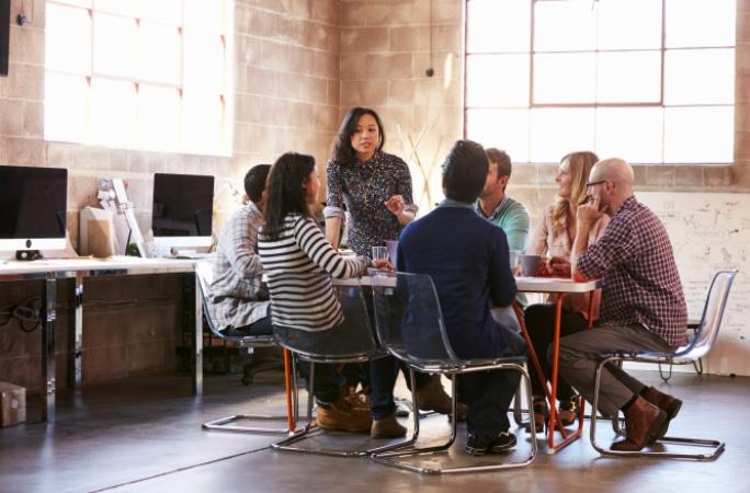 woman leading meeting female leadership
