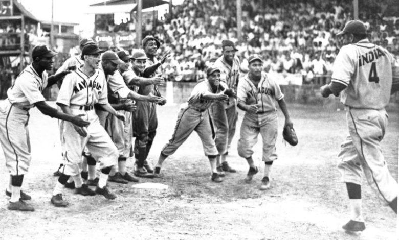 Mayaguez Indians celebrate Johnny Davis' walk-off homer.