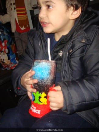 James Rumayor enjoys his slushy out of a special Mickey Mouse cup