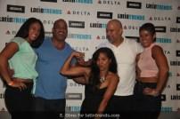 LatinTRENDS Associate Editor Maria V. Luna, center, with the Serrano Sister, trainer Joe Maldonado (white shirt) and Victor Martinez. body builder