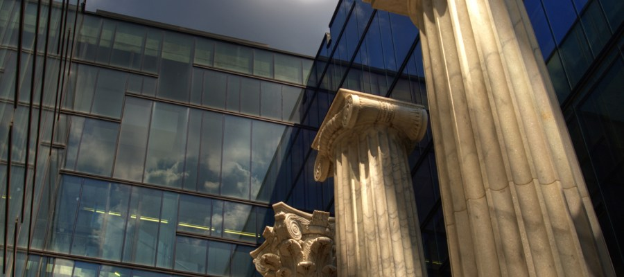 Roman columns against contemporary glass structure