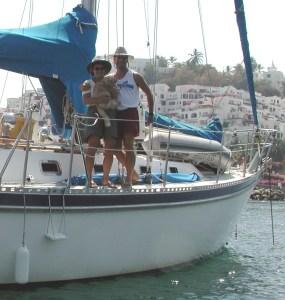 John, Susan and Roscoe aboard Compañía, at anchor in Las Hadas, Mexico