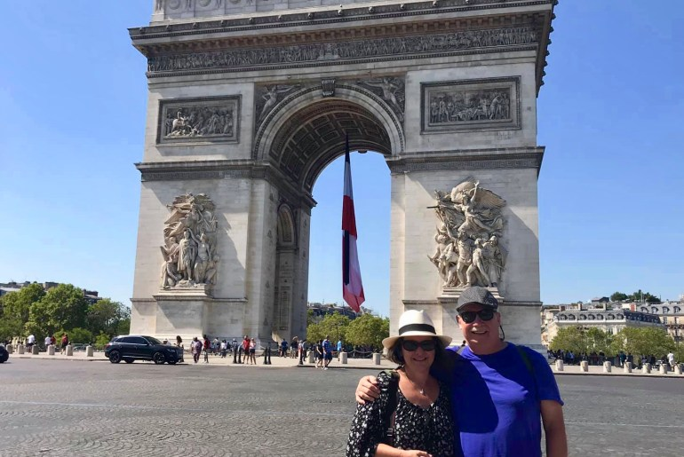 Pazeras standing in front of the Arch de Triomphe in Paris