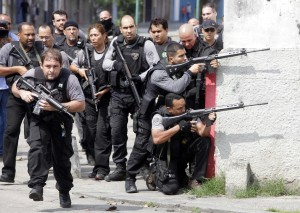 Police officers during a shootout with drug traffickers in the Vila Cruzeiro favela in Rio de Janeiro in 2010. (Reuters/Bruno Domingos)