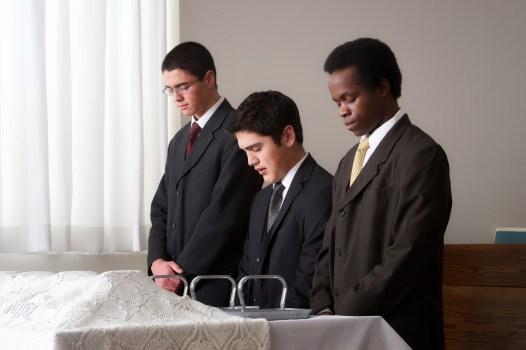 Priests blessing sacrament