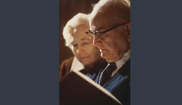 elderly couple reading.