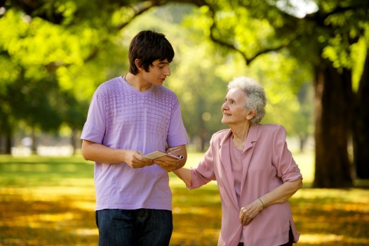 young man with an elderly woman