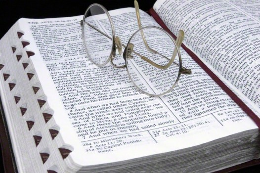 glasses on scriptures