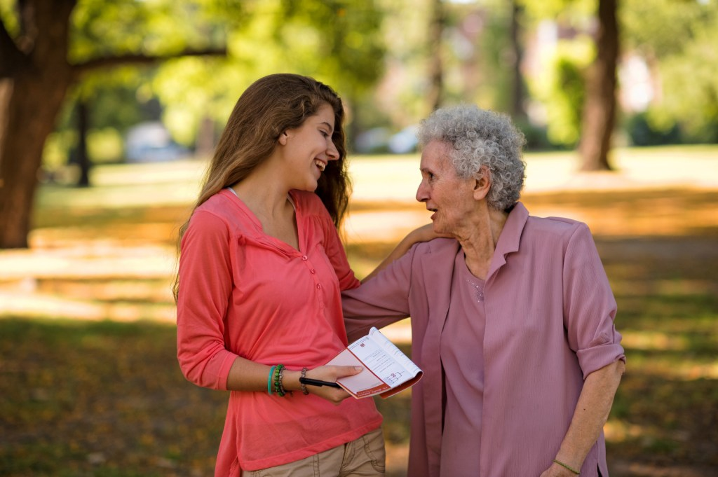 young woman talking and smiling with an older woman