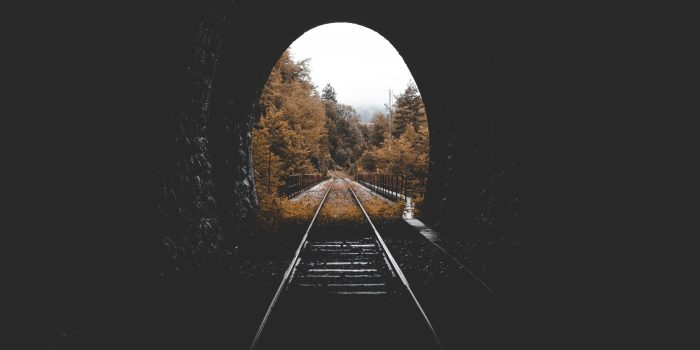 Tunnel over railroad tracks in the fall.