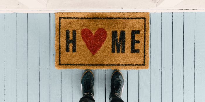 A doormat that says HOME.